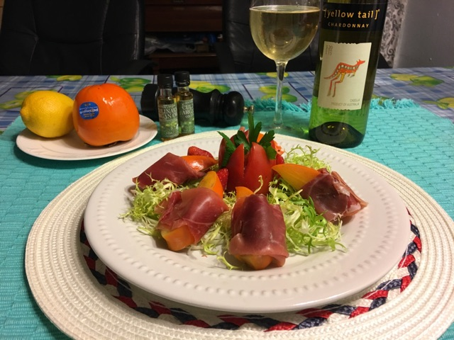 PERSIMMONS WRAPPED IN PROSCIUTTO HAM WITH FRISEE SALAD SPRINKLED WITH ARGAN OIL