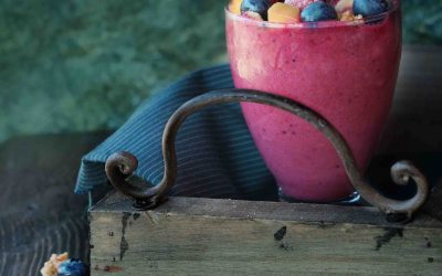 Berry smoothie with  almond milk, granola muesly and nuts - healthy breakfast. on a wooden table